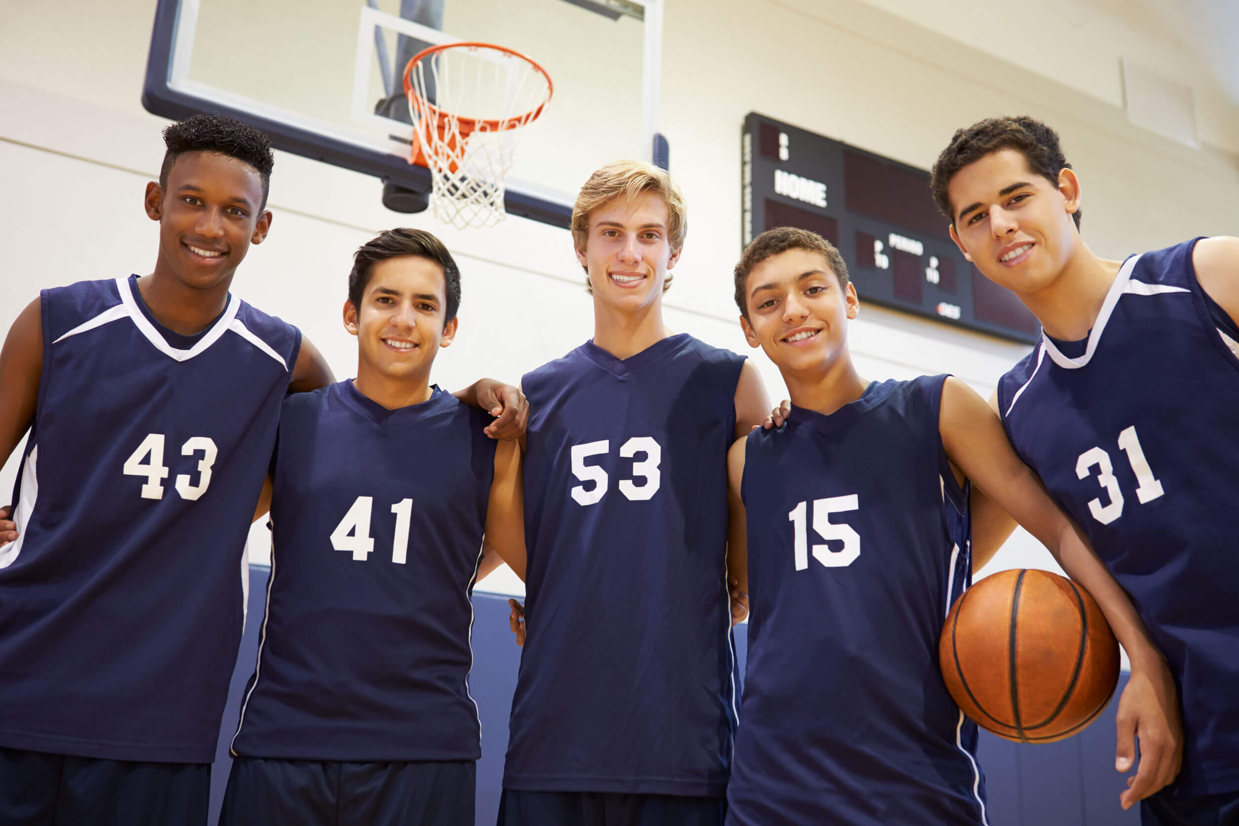 33474402 - members of male high school basketball team